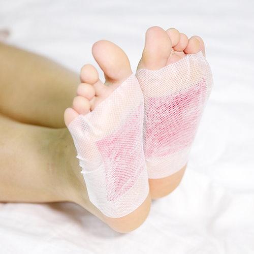 rose detox foot pads on feet image